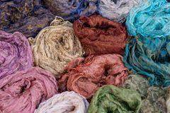 Many colorful scarves for sale at market. Colorful background Royalty Free Stock Photography