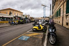 Many colorful scooters parked near a train station in Rome Stock Photos
