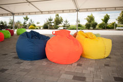 Many colorful soft beanbag seats stock photography