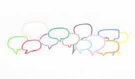 Many colorful speech bubble from color pencil on white paper Stock Photos