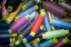 Many colorful spools of thread for sewing background Royalty Free Stock Photos