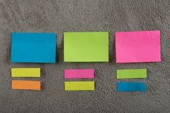 Many colorful sticky note on grey cement background. Copy space royalty free stock photo