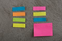 Many colorful sticky note on grey cement background. Copy space stock photos