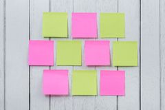 Many colorful sticky note, post note or post-it on white wooden Stock Photography
