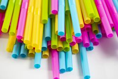 Many colorful straw on white background. Colorful straw on the white background for beverage drink royalty free stock photos