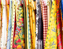 Many Colorful Table Cloths at a French Market Royalty Free Stock Photography