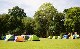 Many colorful Tents on the grass fields at Huay Kamin Waterfall Stock Photo