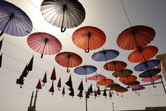 Many colorful umbrellas against the sky in city settings, Iran. Stock Image