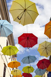 Many colorful umbrellas strung across the street Stock Photo