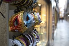 Many Colorful Venetian Style Masks Souvenirs in Venice, Italy. masks at a souvenir shop in the street of Venice, Italy. Masks have stock photos
