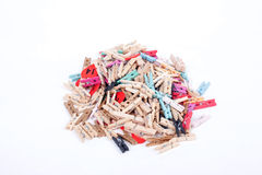 Many colorful wood pegs pins on white background Royalty Free Stock Photos
