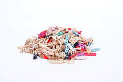 Many colorful wood pegs pins on white background Royalty Free Stock Photography
