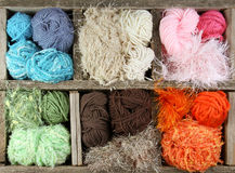 Many colorful yarns in wooden box Stock Photography