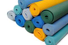 Many colorfull yoga mats as a background. Isolated on white background Royalty Free Stock Image