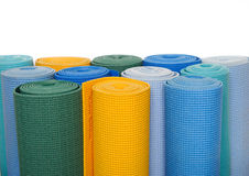 Many colorfull yoga mats as a background. Isolated on white background Royalty Free Stock Photography
