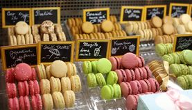 Many colors french macaroon in a stand beautiful and tasty cookie baked macaroon biscuit of assorted colors and different taste Stock Photos
