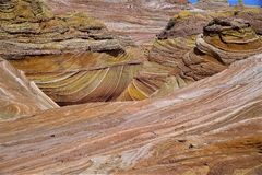 Layers of Sandstone at Coyote Buttes. Many colors and layers of sand stone at Coyote Buttes also The Wave Stock Photography