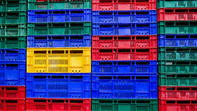 Many colors stack of plastic crates background Royalty Free Stock Images