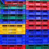 Many colors stack of plastic crates background Royalty Free Stock Photography
