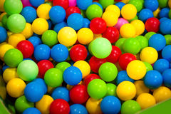 Many colour plastic balls for background. The color ball colorfull for children. soft focus of colorful plastic ball in playground for kid Stock Photo