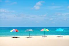 Many-coloured beach parasol sunshades Stock Images