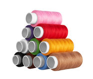 Many-coloured bobbins of thread Stock Images