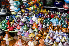 Many coloured tajines for sale in a market Stock Images