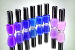 Many colourful bottles of nail polish on grey background. Close up. High resolution Royalty Free Stock Photos