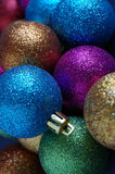 Many colourful christmas baubles Stock Image