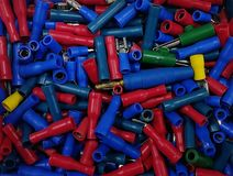 Many colourful plastic tubes in box royalty free stock photography