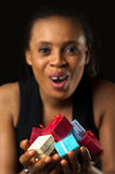 Gifts holding woman. African American woman holding many varicolored / varicoloured gifts for you Royalty Free Stock Photo