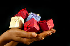 Many colourful presents for you. African American woman holding many varicolored / varicoloured gifts for you stock photo