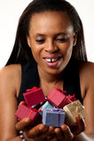 Gift holding African American woman. African American woman holding many varicolored / varicoloured gifts for you royalty free stock photos