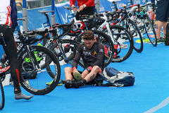 Many competitors preparing before triathlon race stock image
