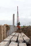 Many concrete pillars with cranes. Stock Images