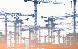 Many construction cranes  - construction site Stock Photo