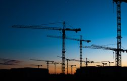 Free Many Construction Cranes On Sunset Sky , Crane Silhouette Skyline Stock Photography - 91522532