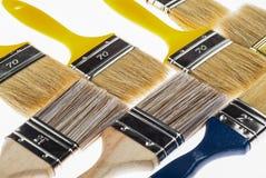 Many construction paintbrushes Stock Photos