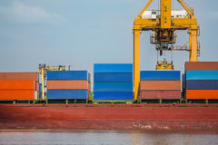 Many containers on the truck bulk carriers and yellow crane harbor quayside Stock Photo