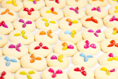 Many cookies on baking tray. Cookies with lollies on white tray Stock Photography