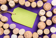 Many cork stoppers with green label on purple background Royalty Free Stock Images