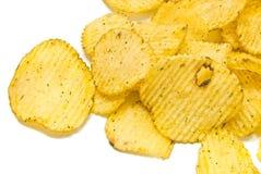 Many corrugated potato chips on white Stock Images