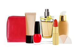 Many cosmetics and red makeup bag Stock Photography