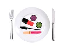Many cosmetics on white plate isolated on white Stock Photography