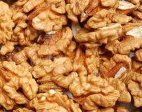 Many cracked walnuts. Close up Stock Photos