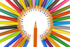 Many crayons in circle as symbol for teamwork Stock Photo