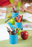 Many crayons on table in preschool Royalty Free Stock Images