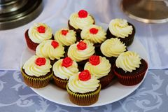 Many cup cake on plate stock image