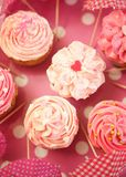 Cupcakes decorated with sprinkles and frosting Stock Photo