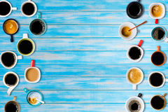 Many cups of coffee on blue background. Top view Stock Photos